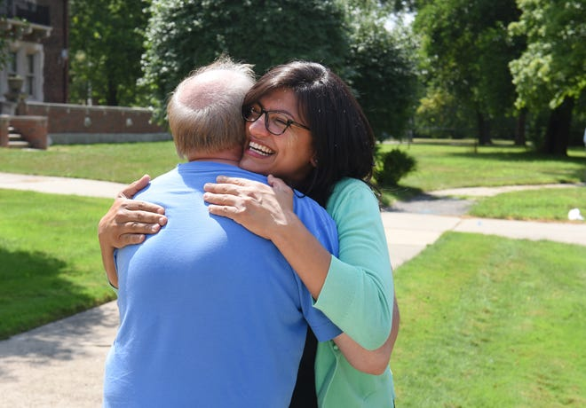 Rashida Tlaib is congratulated by a supporter after she was interviewed by local media on Wednesday, August 8, 2018 in Detroit about being the first Muslim woman elected to Congress.