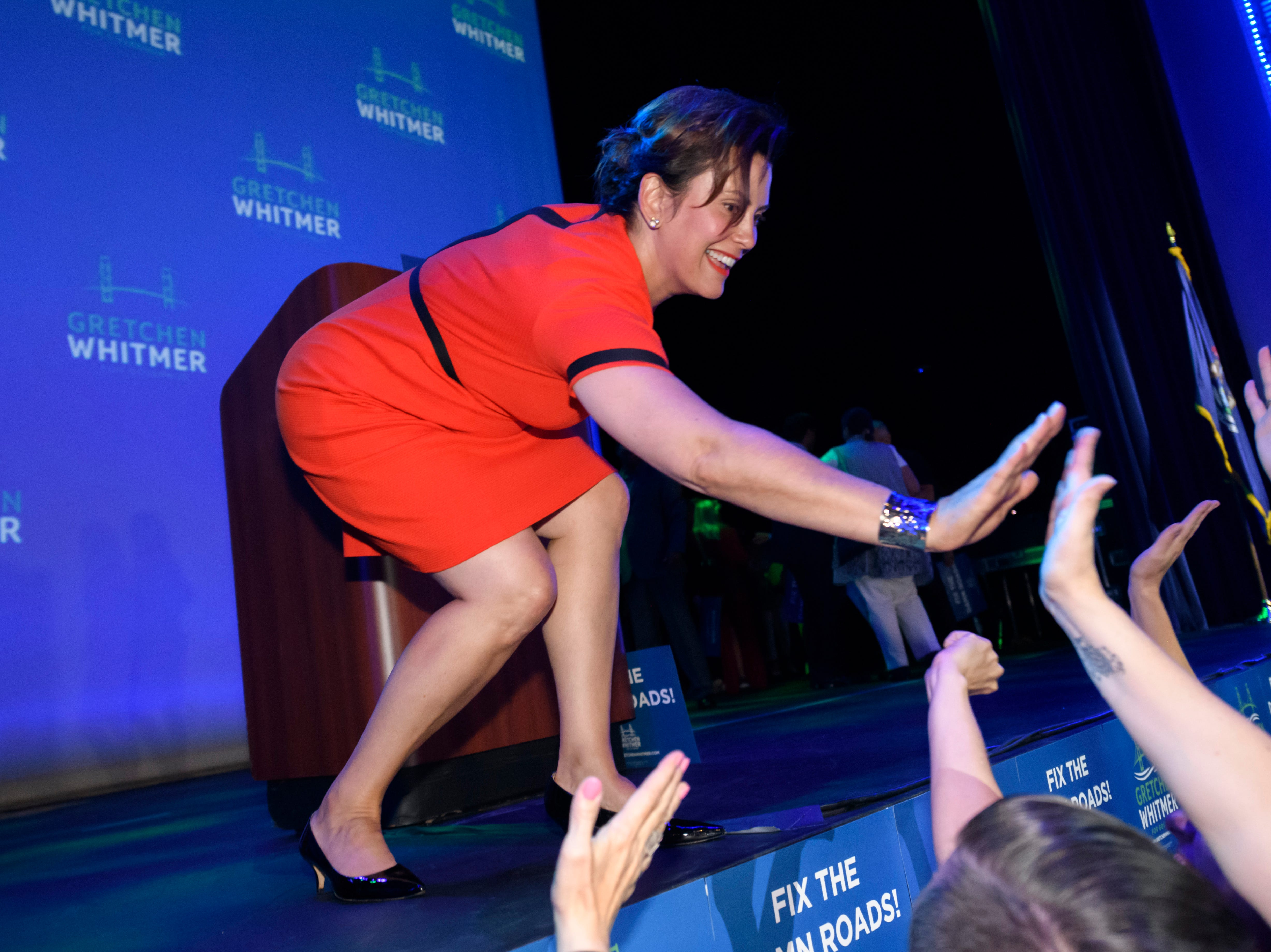 Michigan gubernatorial candidate Gretchen Wilmer high fives her supporters during her election night victory party