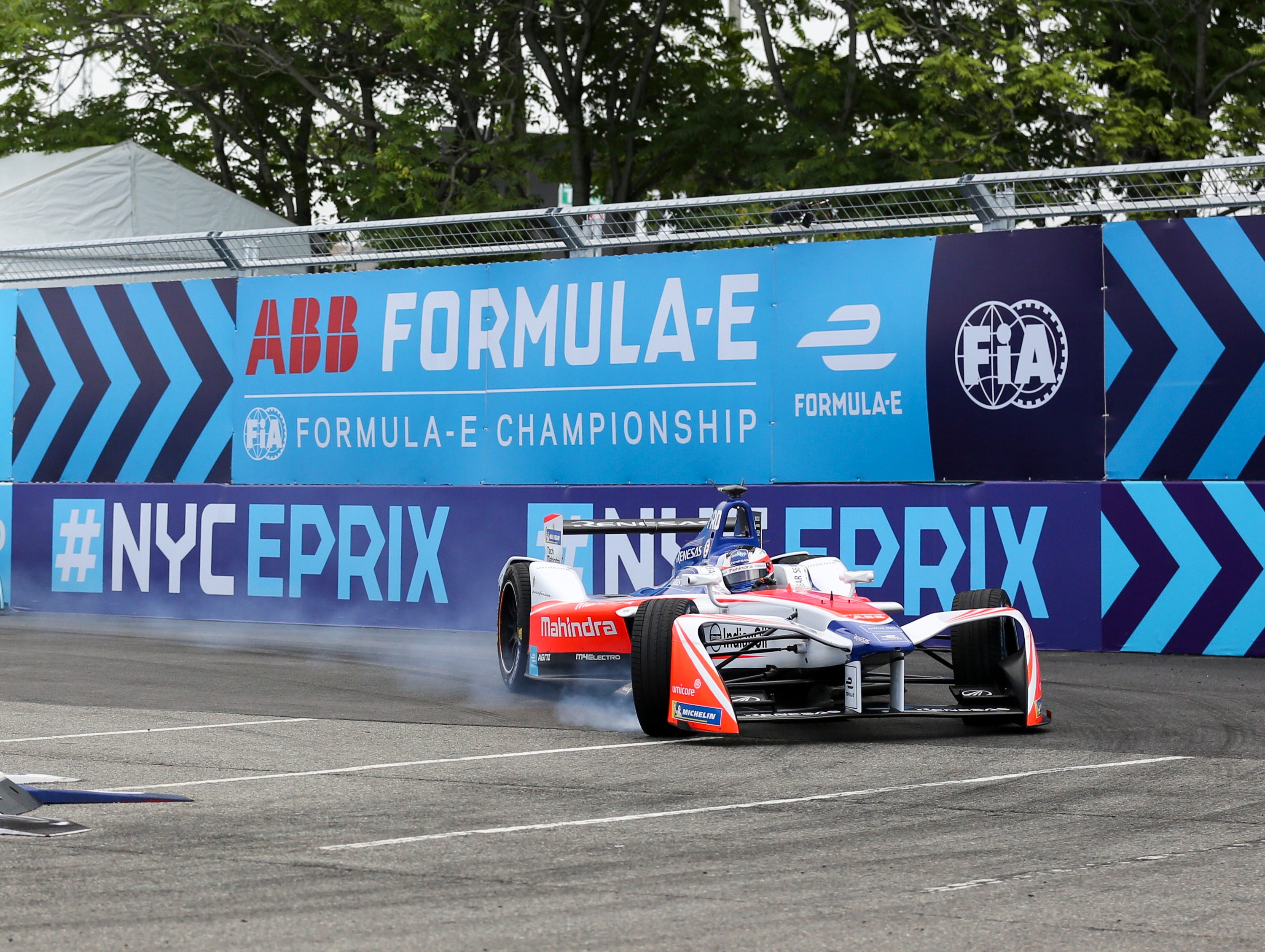 Mahindra Racing's Felix Rosenqvist takes a hairpin turn during the second of two auto races in the Formula E championship on Sunday, July 15, 2018, in Brooklyn, New York.