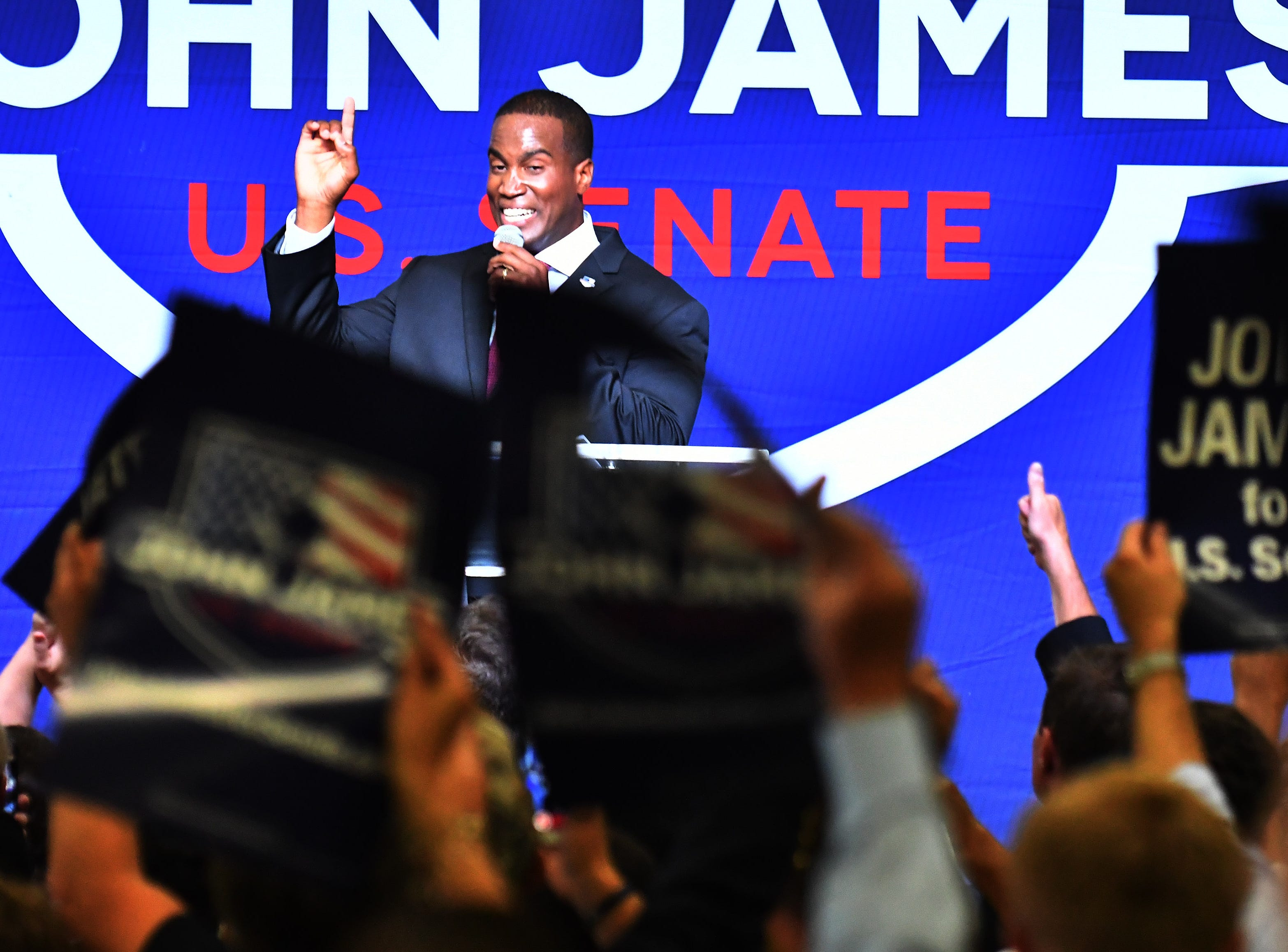Republican Senate candidate John James speaks at his election night party.