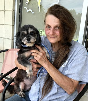 Linda Reichel, operator of A Voice for All Animals/Second Chance Ranch, holds Margie, one of her rescue dogs.