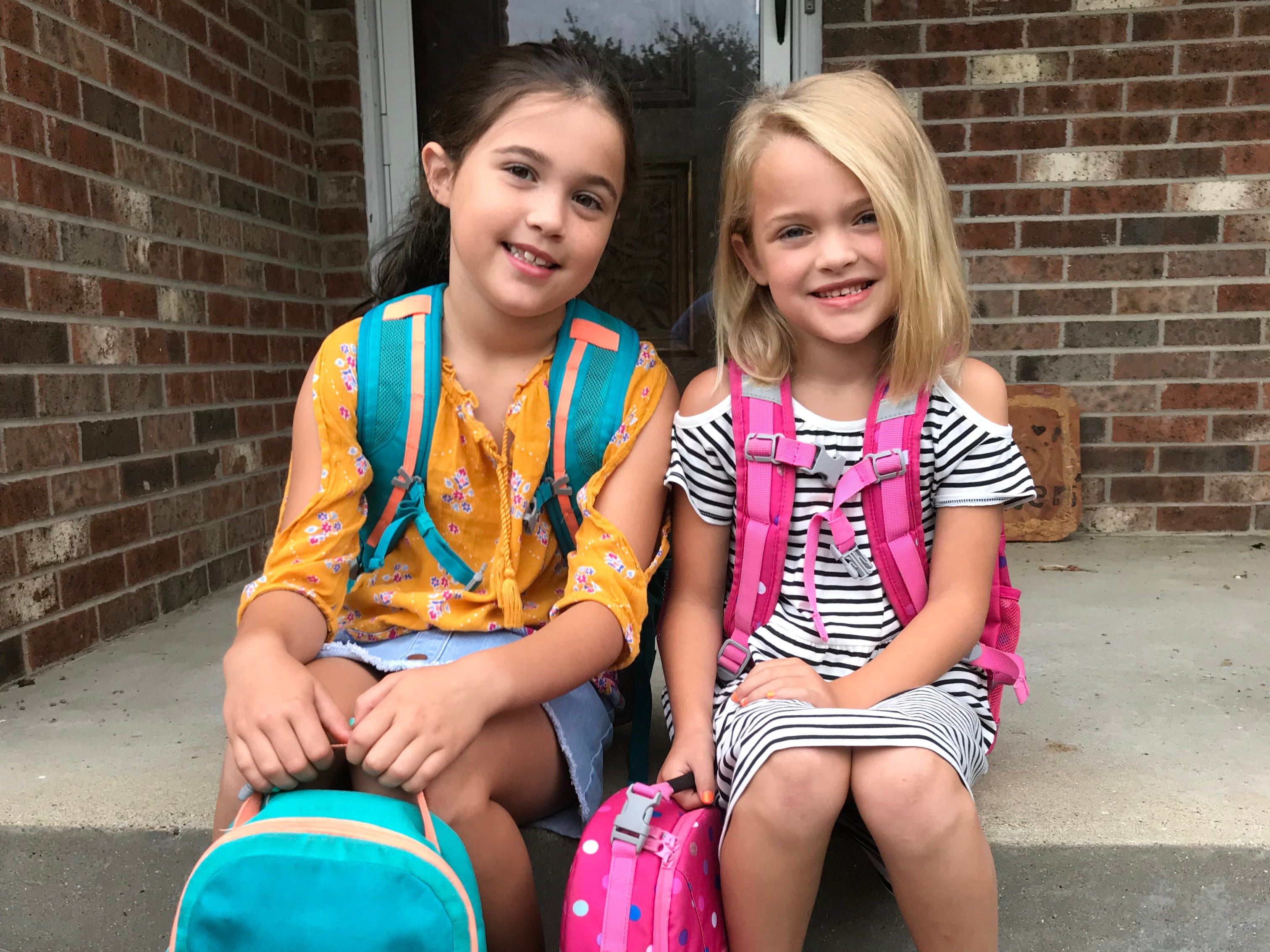 Lucy and Amelia.  Grades 3 and 1.