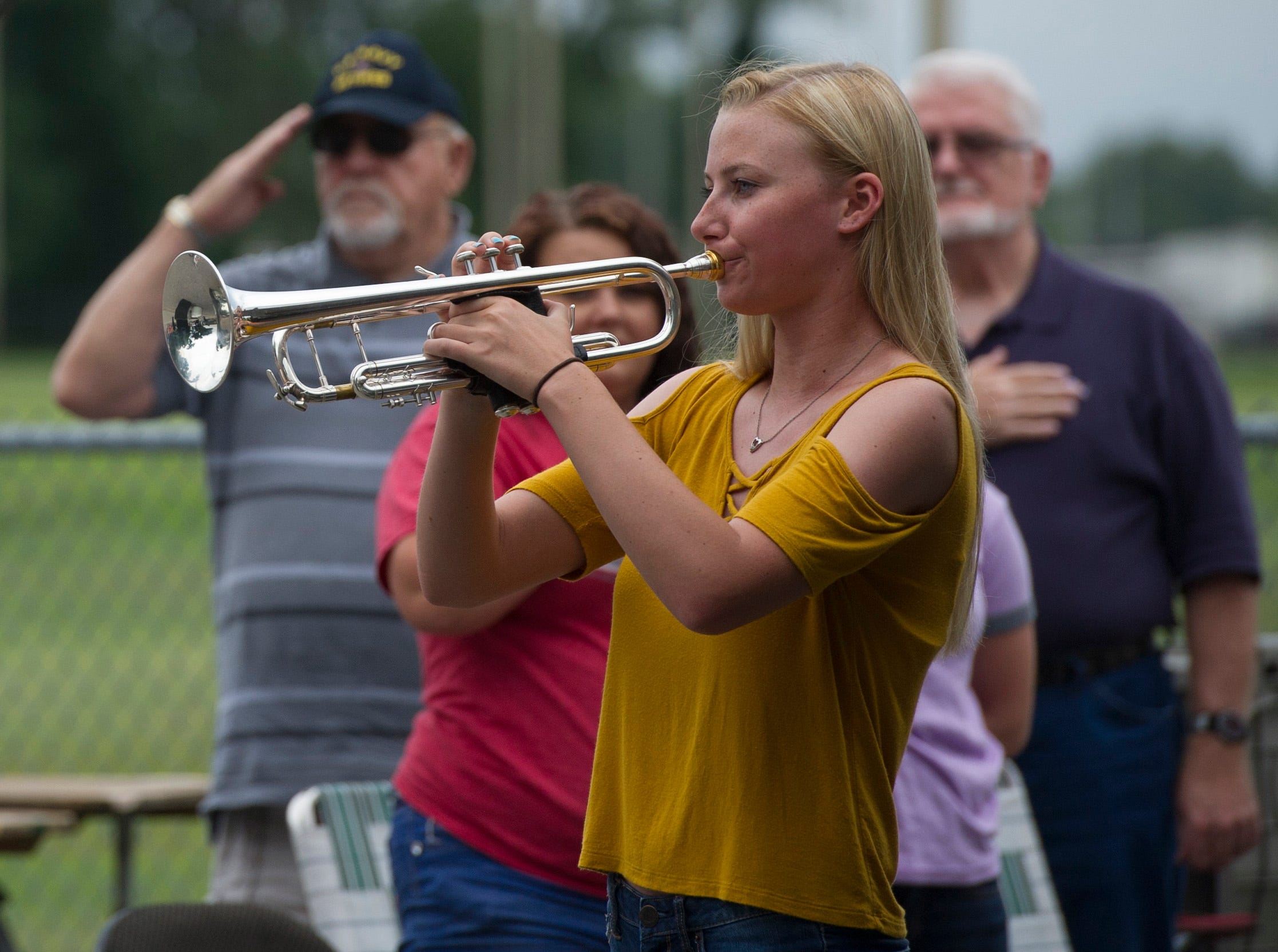 Jillian Belli, 19, performs the national anthem on the trumpet during the 35th National Night Out at Wesselman Park Tuesday, August 7, 2018.