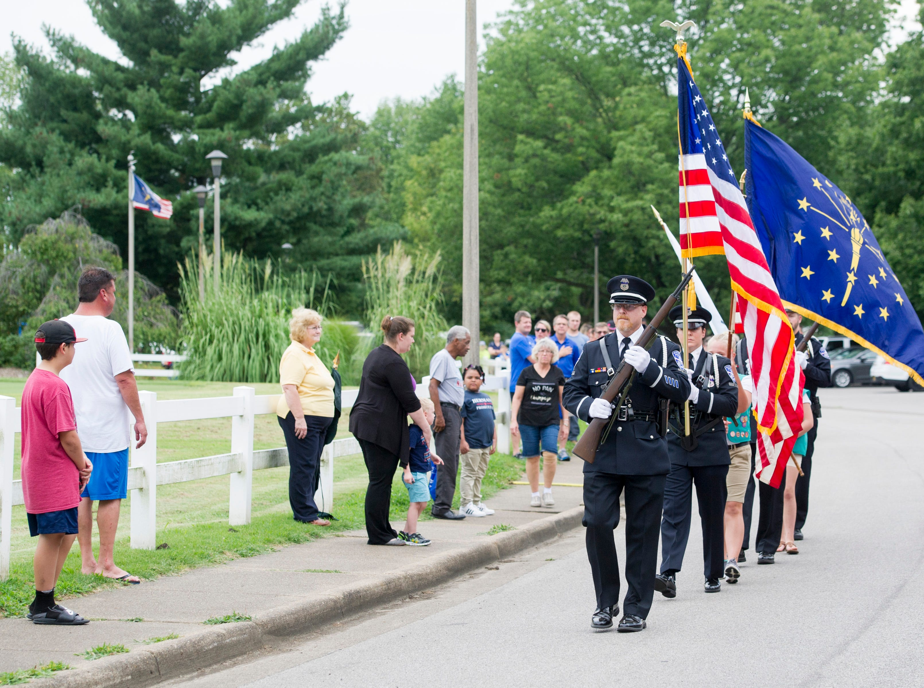 The opening procession at the 35th National Night Out at Wesselman Park Tuesday, August 7, 2018.