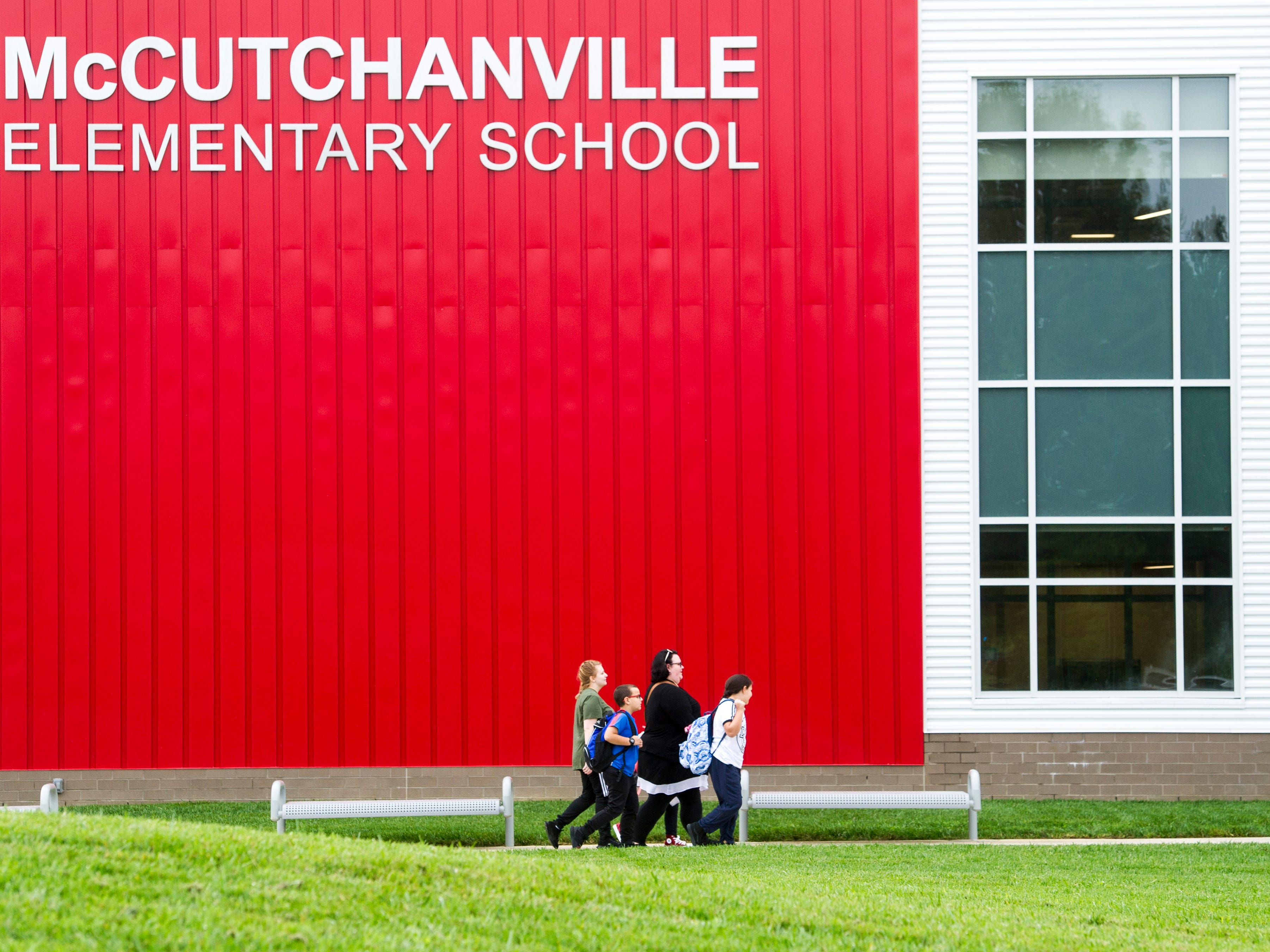 Students arrive at the new McCutchanville Elementary school for the first day of school Wednesday, August 8, 2018.