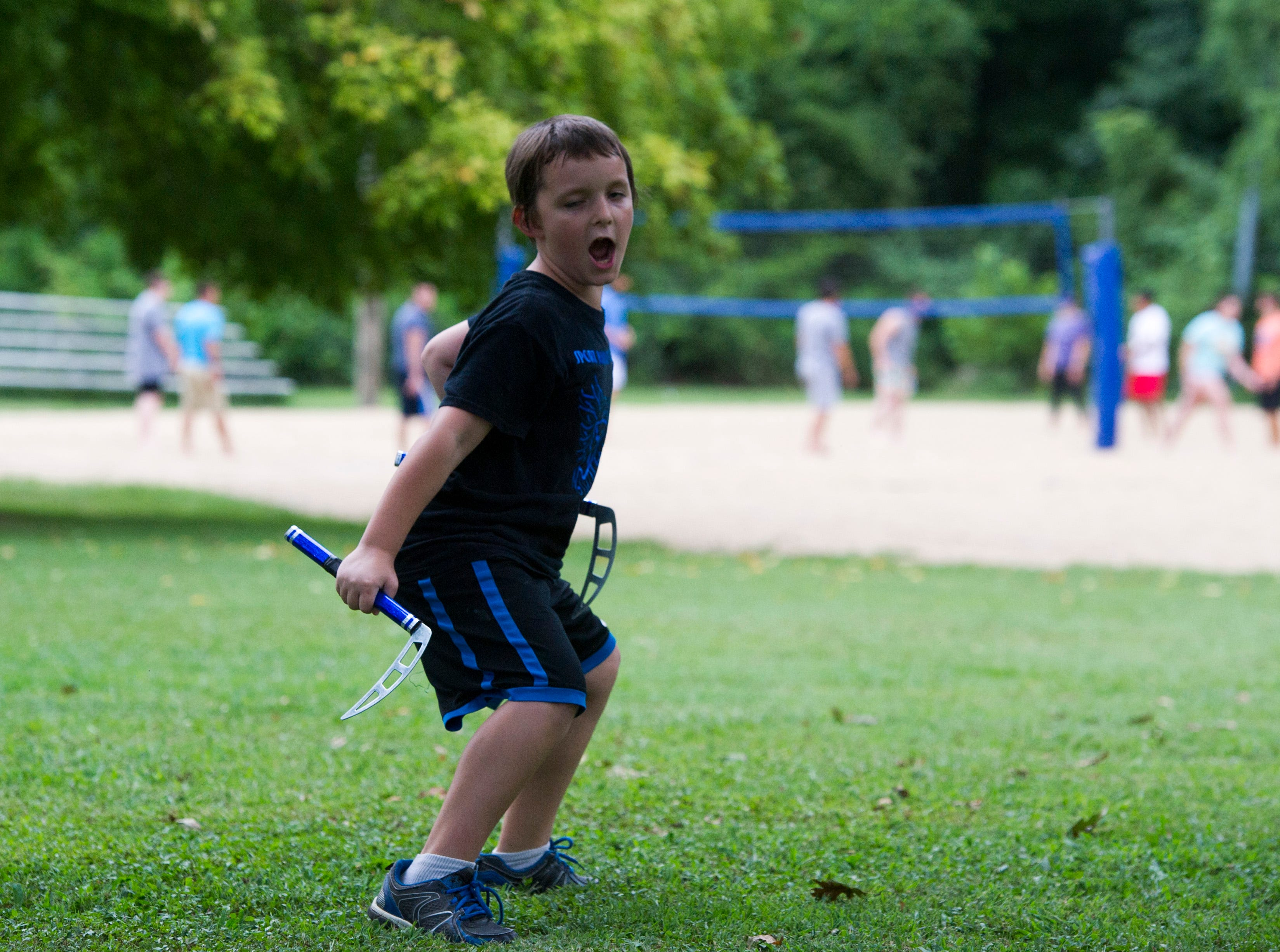Wyatt Schutt shows off his kama skills during the 35th National Night Out held at Wesselman Park Tuesday, August 7, 2018.