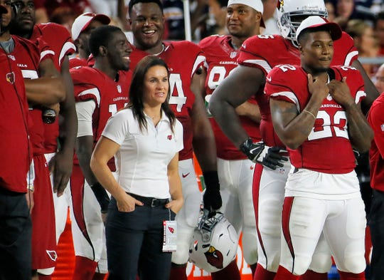 Jen Welter, who was an assistant coach for the Arizona Cardinals during training camp and preseason games in 2015, watches from the sidelines during a preseason game against the San Diego Chargers. Praising the coaches and players for accepting her without reservation, Welter is proud she's opened another door for women in men's professional sports as the first female coach of any kind on an NFL team.
