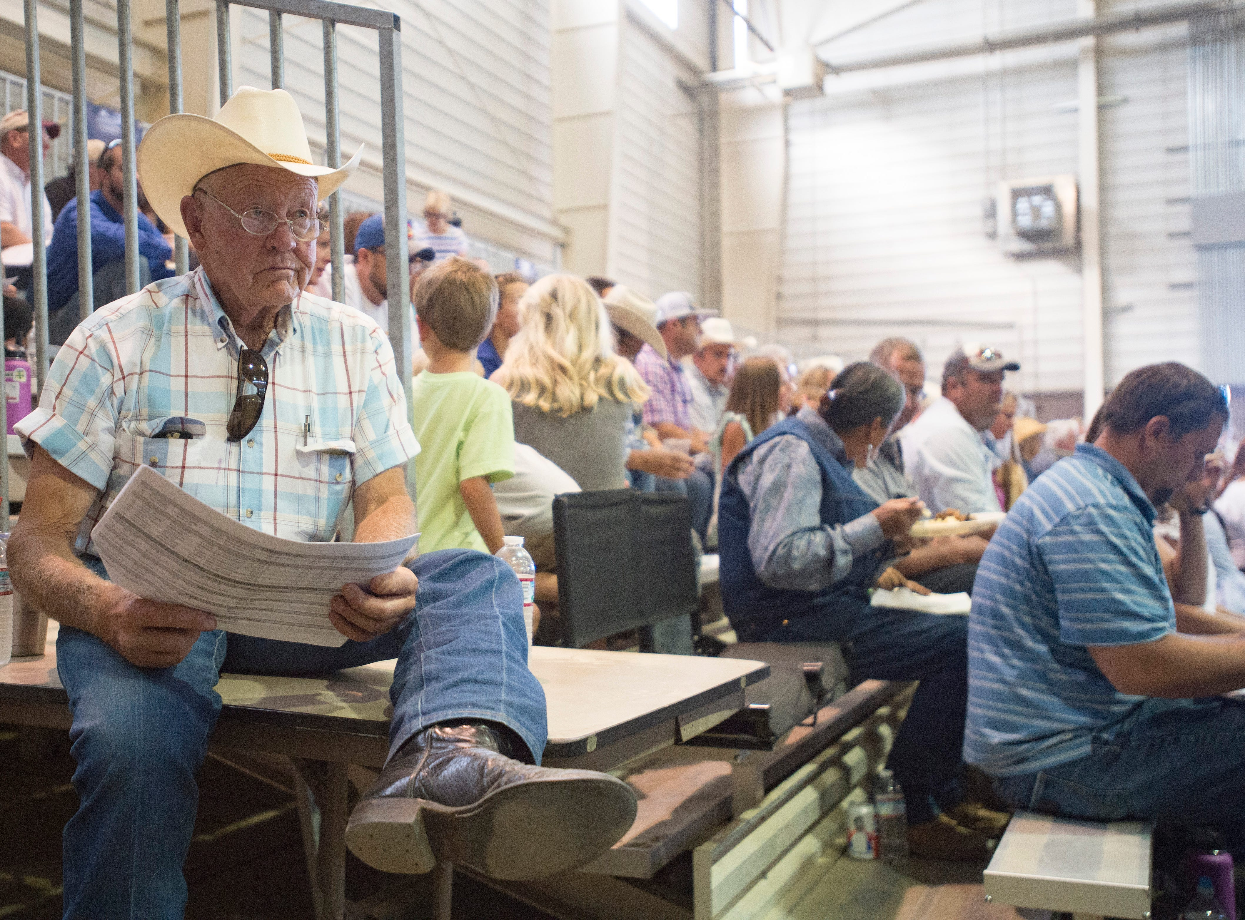 Ed Hansen watches bidding at the Larimer County Fair Youth Livestock Sale at The Ranch in Loveland on Wednesday, August 8, 2018.