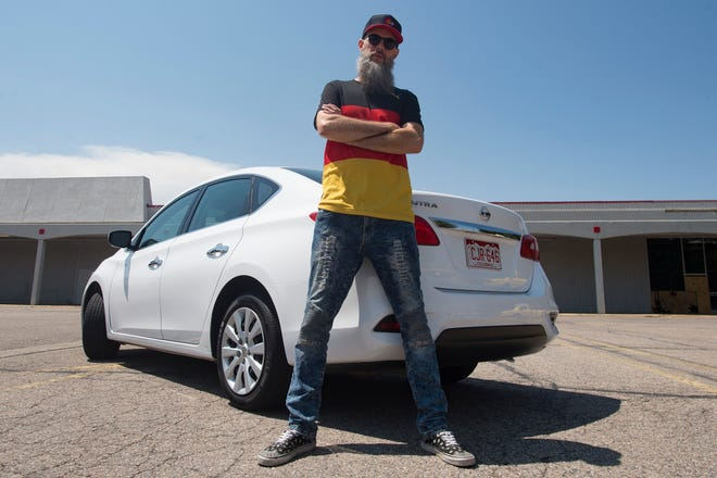 David Petschel, also known as Germoney, poses for a photo on Wednesday, August 8, 2018. The full-time Lyft driver is working to support his dream of music, hailing himself as the first German rapper in the United States.