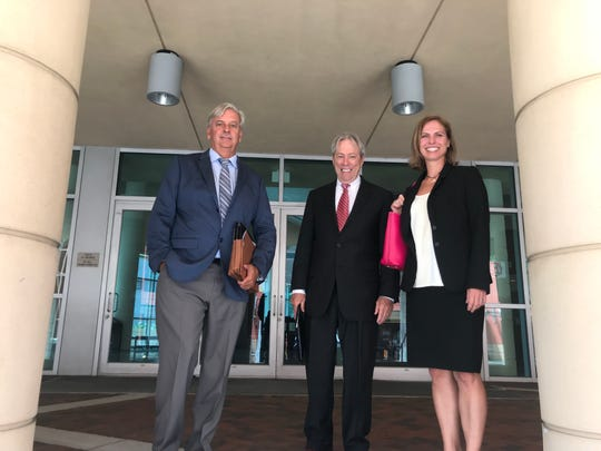 Residents'  attorneys Gary Davis, Ralf Brookes and Natalie Barefoot leave the U.S. Middle District courthouse in Fort Myers on Wednesday after the first hearing in a case brought by their clients against the city for dumping toxic lime sludge in their neighborhood over 55 years ago and leaving it there.