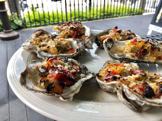 Oysters casino topped with a trio of diced bell peppers from Cape Harbour Oyster Bar in Cape Coral.