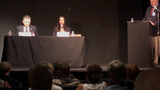 Chief assistant state attorney Amira Fox tells the audience about herself at a League of Women Voters of Lee County forum in July. At left is her opponent in the state attorney race, Chris Crowley.