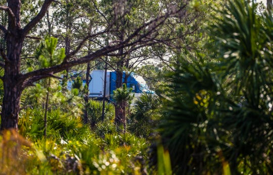 A semi-truck  passes an opening in the trees as it rides south on I-75. Photos of the more than 500 acres north of Tuckers Grade in Charlotte County and west of Interstate 75 that could become a mixed-use development called Tuckers Point, with nearly 1,700 residential units, a 400-room hotel and and roughly 480,000 square feet of commercial space.
