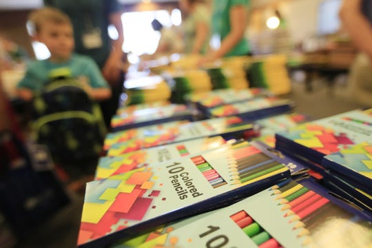 Children browse for school supplies at the Back-to-School Store at University of Wisconsin-Green Bay on Wednesday in Green Bay.