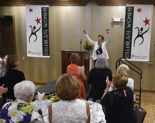 """Tuti Scott concludes her """"Prosperity Together'' speech as the keynote speaker of the Women's Fund of Door County's annual luncheon on Aug. 8, 2018."""
