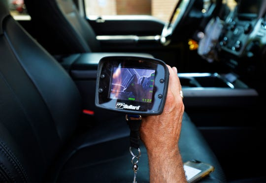 A Great Falls thermal imaging camera is used to measure the temperature of different surfaces in a vehicle to illustrate how hot cars can get.  While the air temperature was 88 degrees the hottest surfaces inside the car, those exposed to direct sunlight, registered between 130 and 140 degrees.
