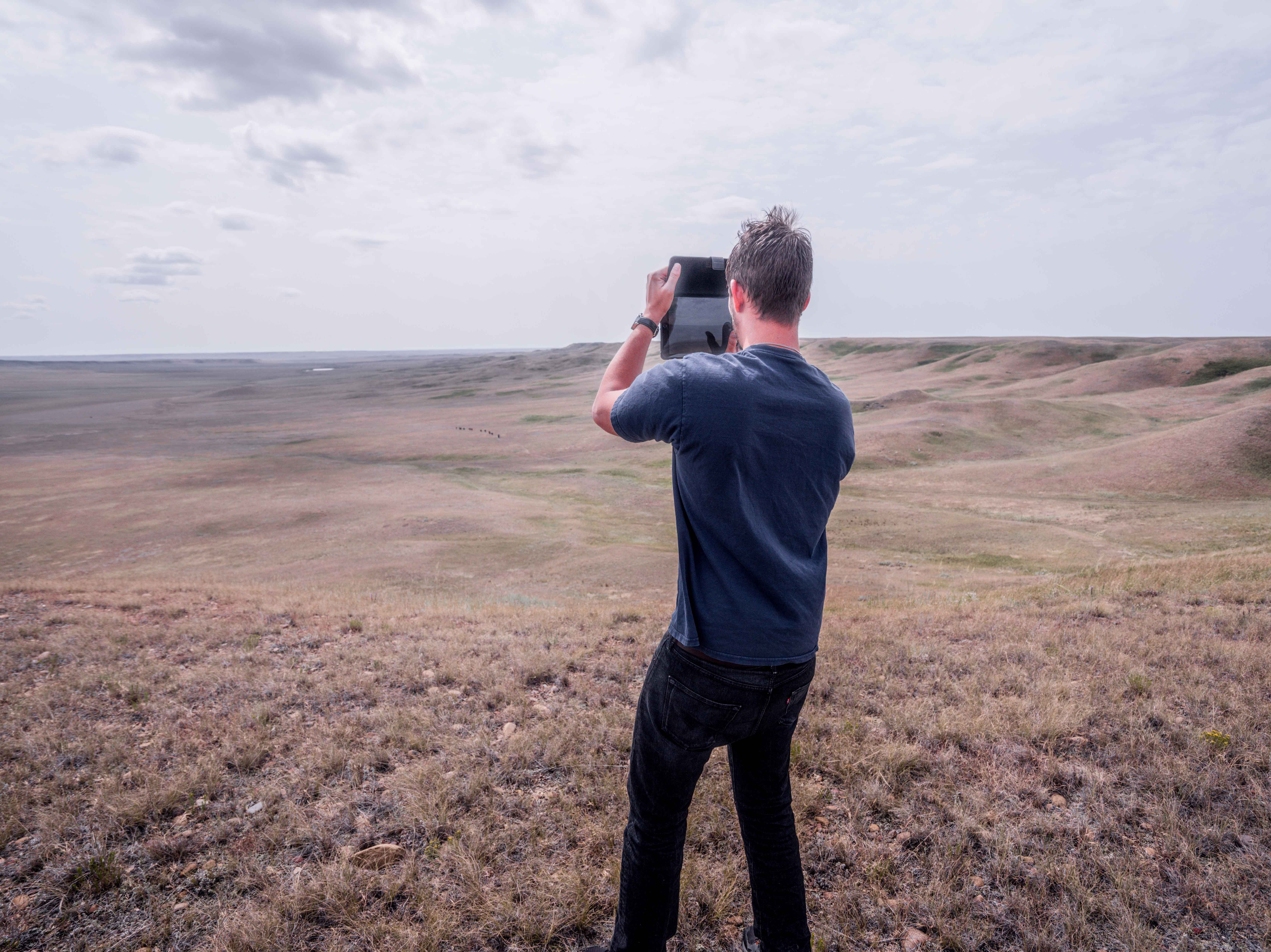 A.J. Etherington of Glasgow takes photos of a remote stretch of Montana west of Larslan.