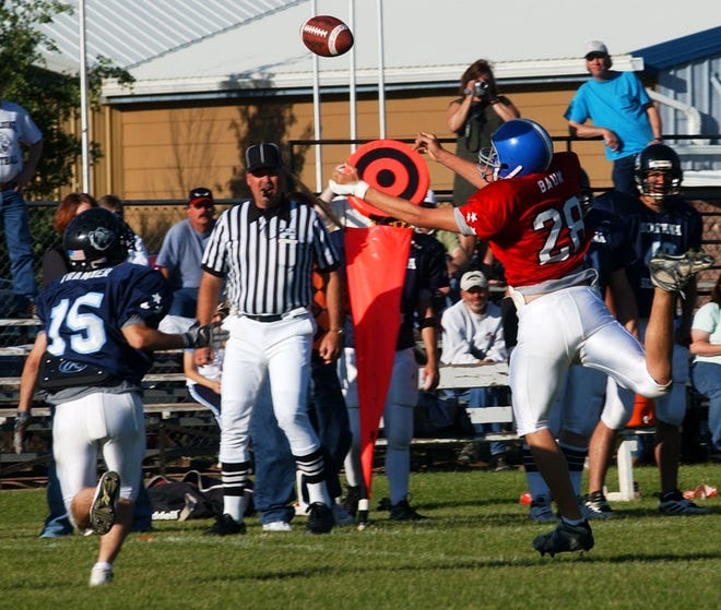 The football sails over intended receiver Jake Baum, of Highwood and was intercepted by Blue Team's Adam Tranmer of Brady in the 2003 Six-Man All-Star game in Fort Benton.