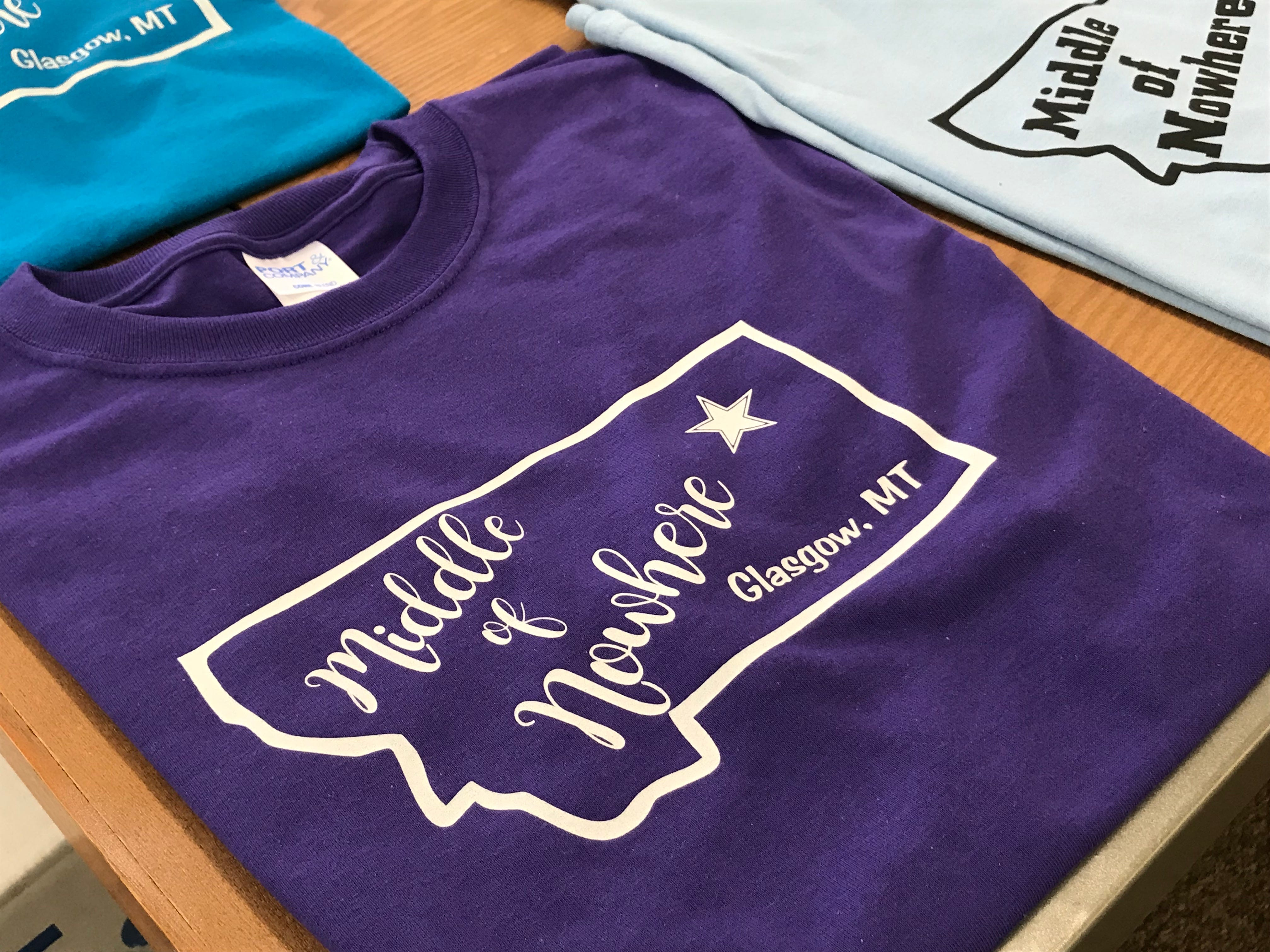 "D & G Sports & Western Wear is selling ""Middle of Nowhere"" shirts. After an Oxford University study, Glasgow was named the most remote town in the contiguous United States."
