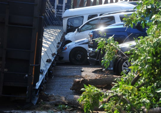 A BNSF train derailment occured on the tracks between the Great Falls Police Department and the Great Falls Tribune building on Wednesday afternoon.  Numerous cars in the police department parking lot were damaged by train cars.