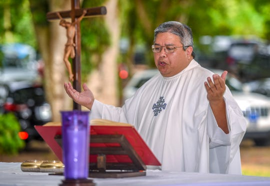 Father Jeff San Nicolas, the vicar general, shown here in this file photo, is on self-quarantine after visiting Guam Memorial Hospital Friday.