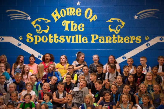 Spottsville Elementary School upperclassmen answer their principal's greeting on the first day of school Wednesday morning.