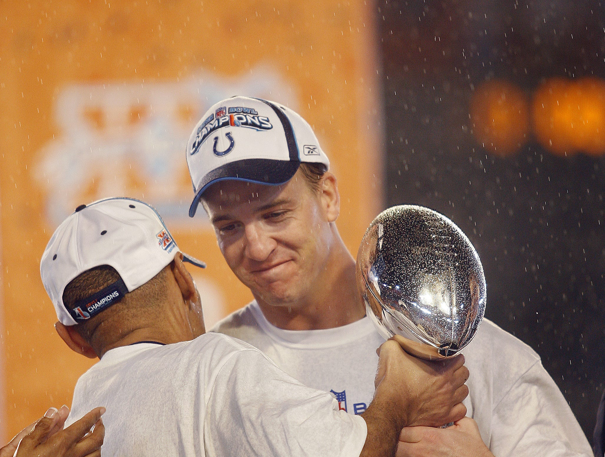Indianapolis Colts head coach Tony Dungy hand the Vince Lombardi Trophy to his quarterback Peyton Manning following the Colts 29-17 win in Super Bowl XLI on February 4, 2007 at Dolphins Stadium in Miami, Fla.