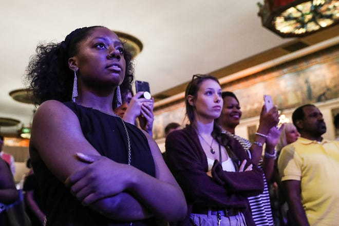 "At left, artist Monique Burts watches as models display her wearable artwork on the runway at MAGNIFY, an artist showcase presented by RAW: Indianapolis at Old National Centre, Wednesday, June 20, 2018. Burts said the short time her models have on stage is worth the sleepless nights of preparation. ""Those three minutes are just amazing up there, I love it. I love every part of it,"" Burts said. ""And it makes me really sad when it's over."""