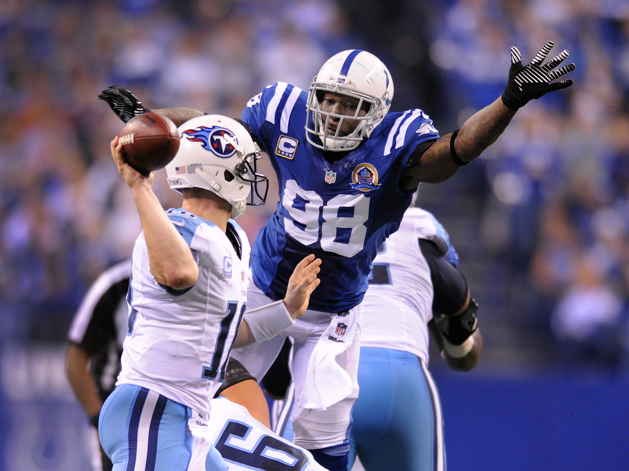 Indianapolis Colts DE Robert Mathis pressures the pass by Tennessee Titans QB Jake Locker,left, in the fourth quarter of their game Sunday, December 9, 2012, afternoon at Lucas Oil Stadium.