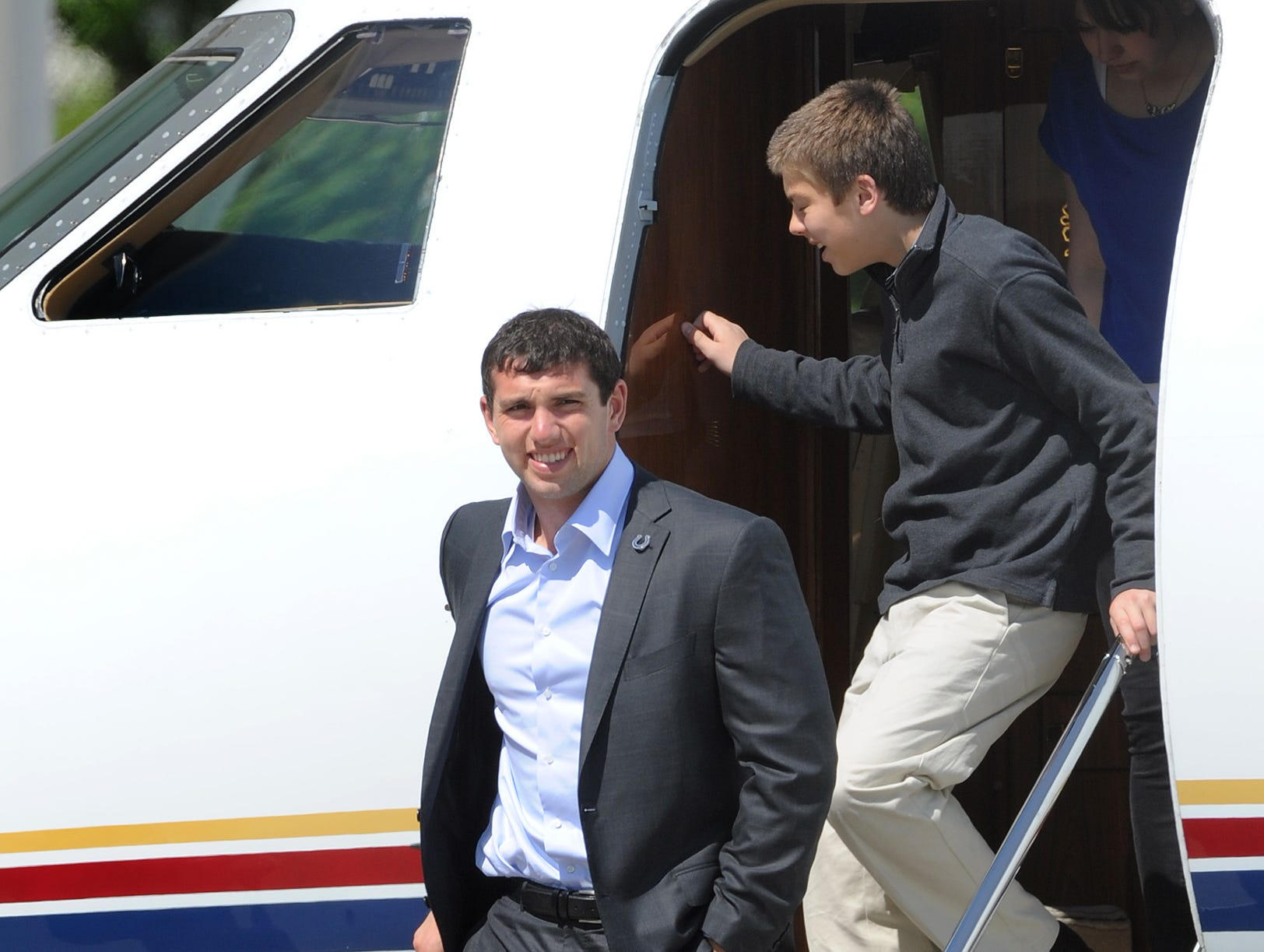 Indianapolis Colts Andrew Luck arrives at the Indianapolis International Airport with the Irsay daughters via a private jet the day following the Colts picking him with the #1 overall in the NFL draft April 27, 2012.