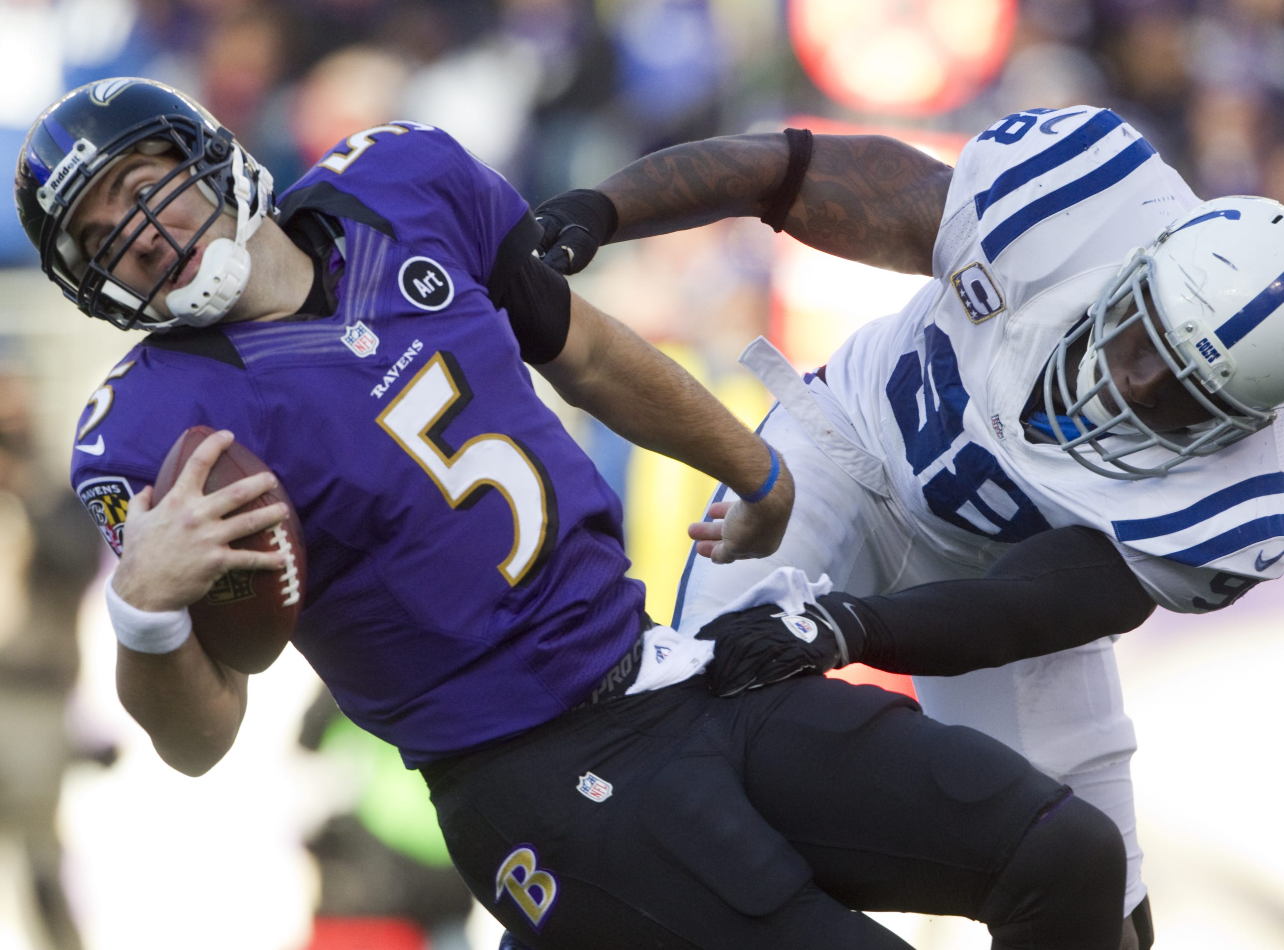 Baltimore Ravens quarterback Joe Flacco is sacked by Indianapolis Colts Robert Mathis at M&T Bank Stadium, Baltimore, MD, Sunday, January 06, 2013.