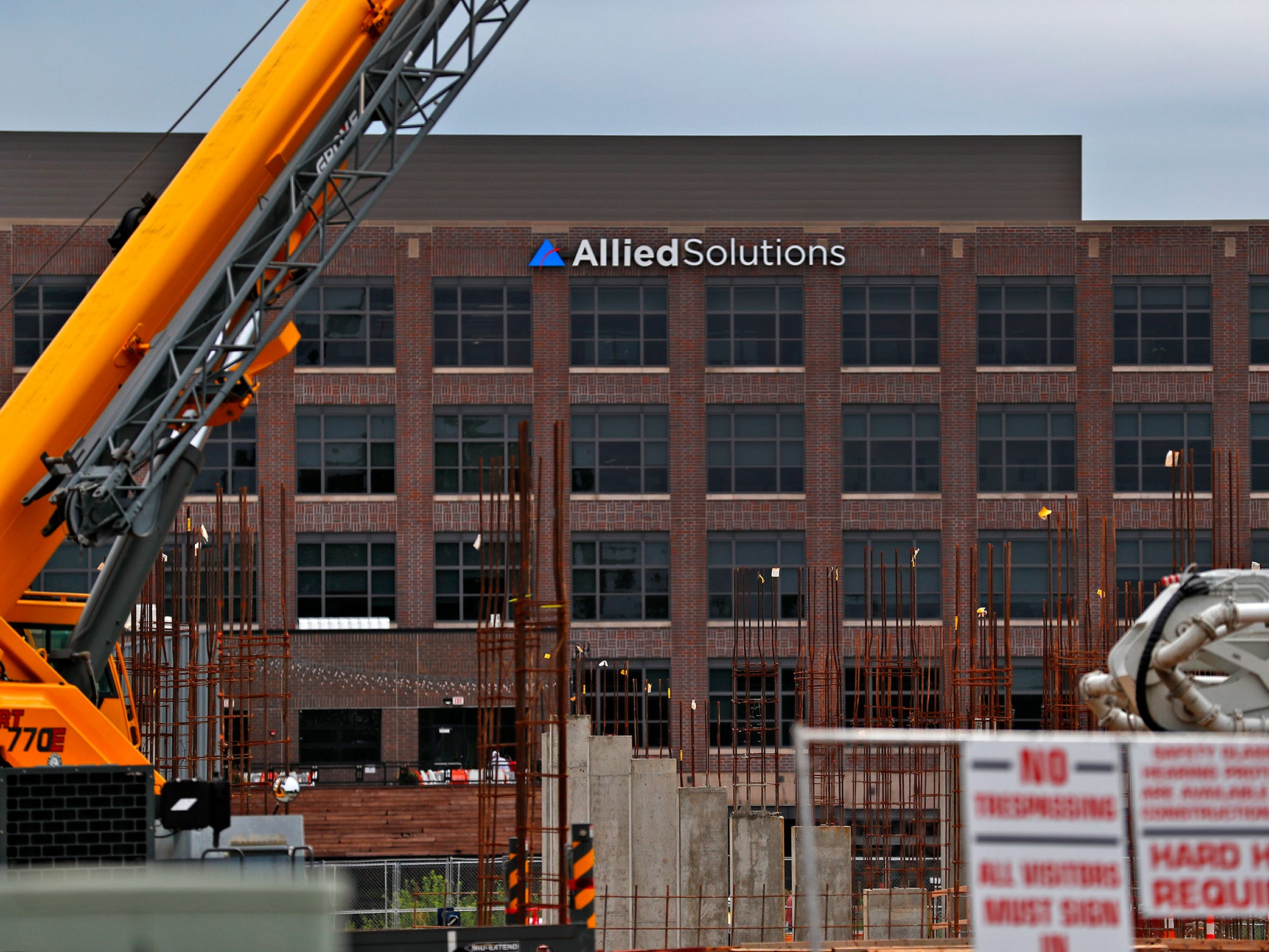 Allied Solutions is seen, past construction in Midtown Carmel, Tuesday, Aug. 7, 2018.