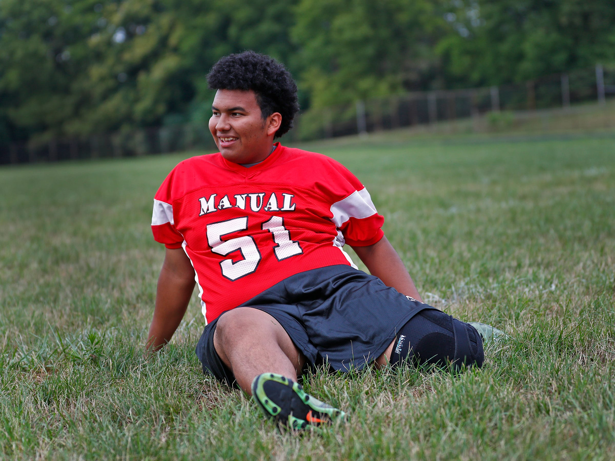 Lester stretches before practicing kicking at Emmerich Manual High School, Monday, July 31, 2018.  He moved to Indianapolis when he was 15 years old and is set to graduate from Manual in 2019.  Lester, an undocumented immigrant from Honduras, dreams of going to college.  He hopes that football will help him pay for that dream.