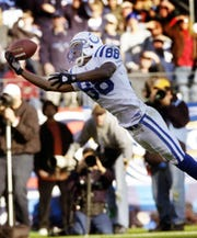 Indianapolis Colts Marvin Harrison makes a spectacular catch for 42-yard catch late in the third quarter of their game Sunday afternoon at The Coliseum in Nashville TN. on Dec 7, 2003.