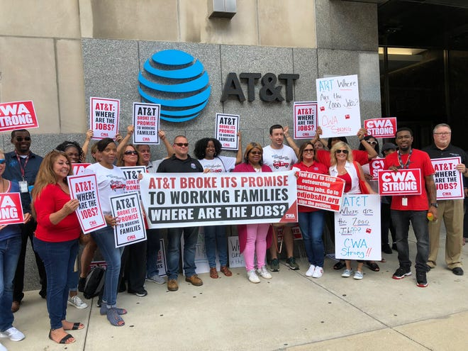 Local AT&T workers and labor leaders with the Communications Workers of America rallied outside of the AT&T Building in Indianapolis Wednesday, August 8, 2018, to protest job cuts made by AT&T since a sweeping federal tax cut was signed into law by President Donald Trump in December 2017.