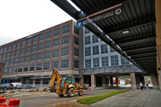 Allied Solutions, 350 Veterans Way, is seen from the west in Midtown Carmel, Tuesday, Aug. 7, 2018. The city extended 4th Street through the building as part of the project.