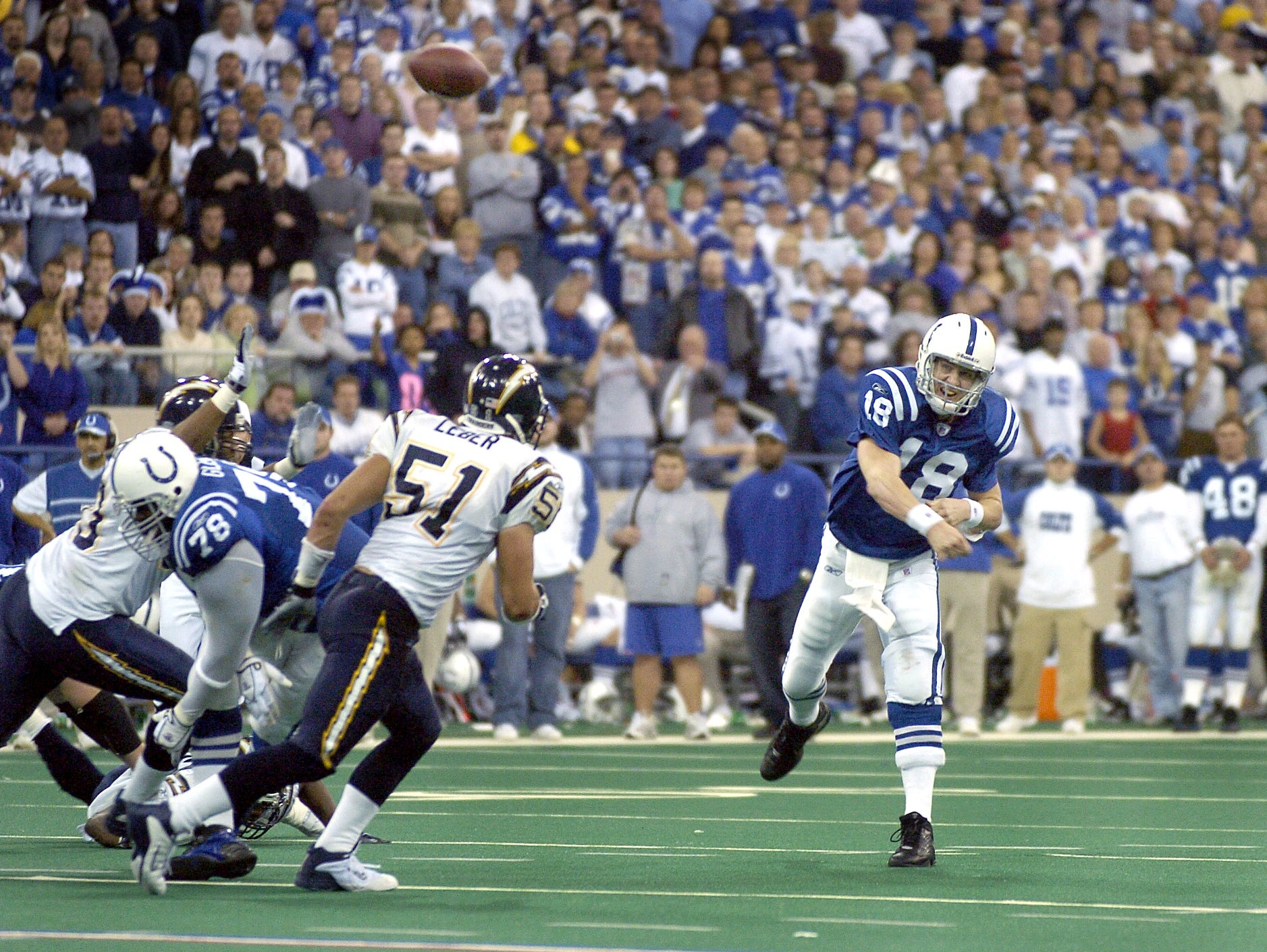 Indianapolis Colts Peyton Manning throws his 49th touchdown of the season to receiver Brandon Stockley late in the fourth quarter of their game against the San Diego Chargers Sunday afternoon at the RCA Dome on Dec 26, 2004.