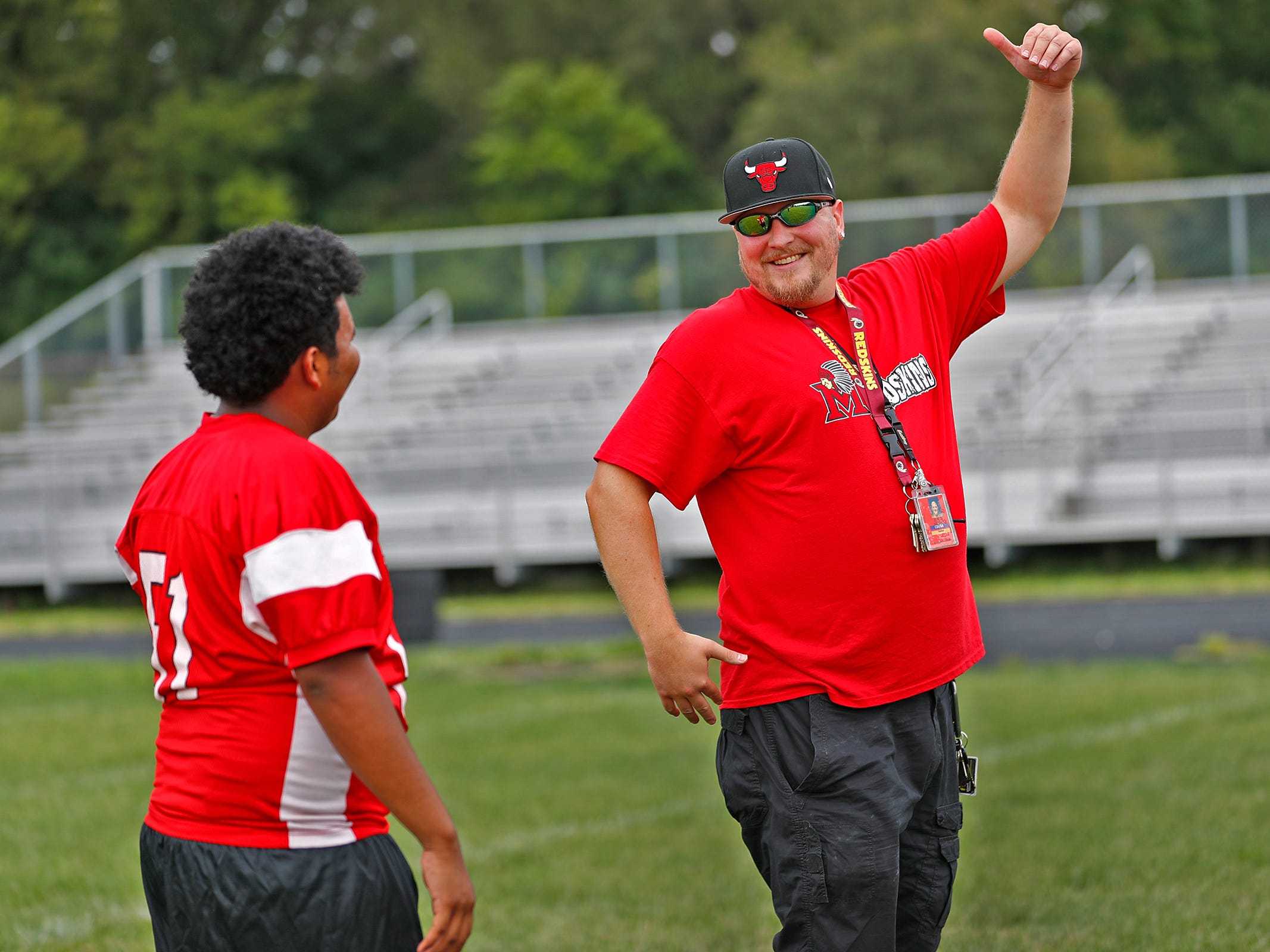 Jerod Kienitz, special teams and receiving coach for the Manual High School football team, right, works with team kicker, Lester, during practice at Emmerich Manual High School, Monday, July 31, 2018.  Lester moved to Indianapolis when he was 15 years old and is set to graduate from Manual in 2019.  Lester, an undocumented immigrant from Honduras, dreams of going to college.  He hopes that football will help him pay for that dream.
