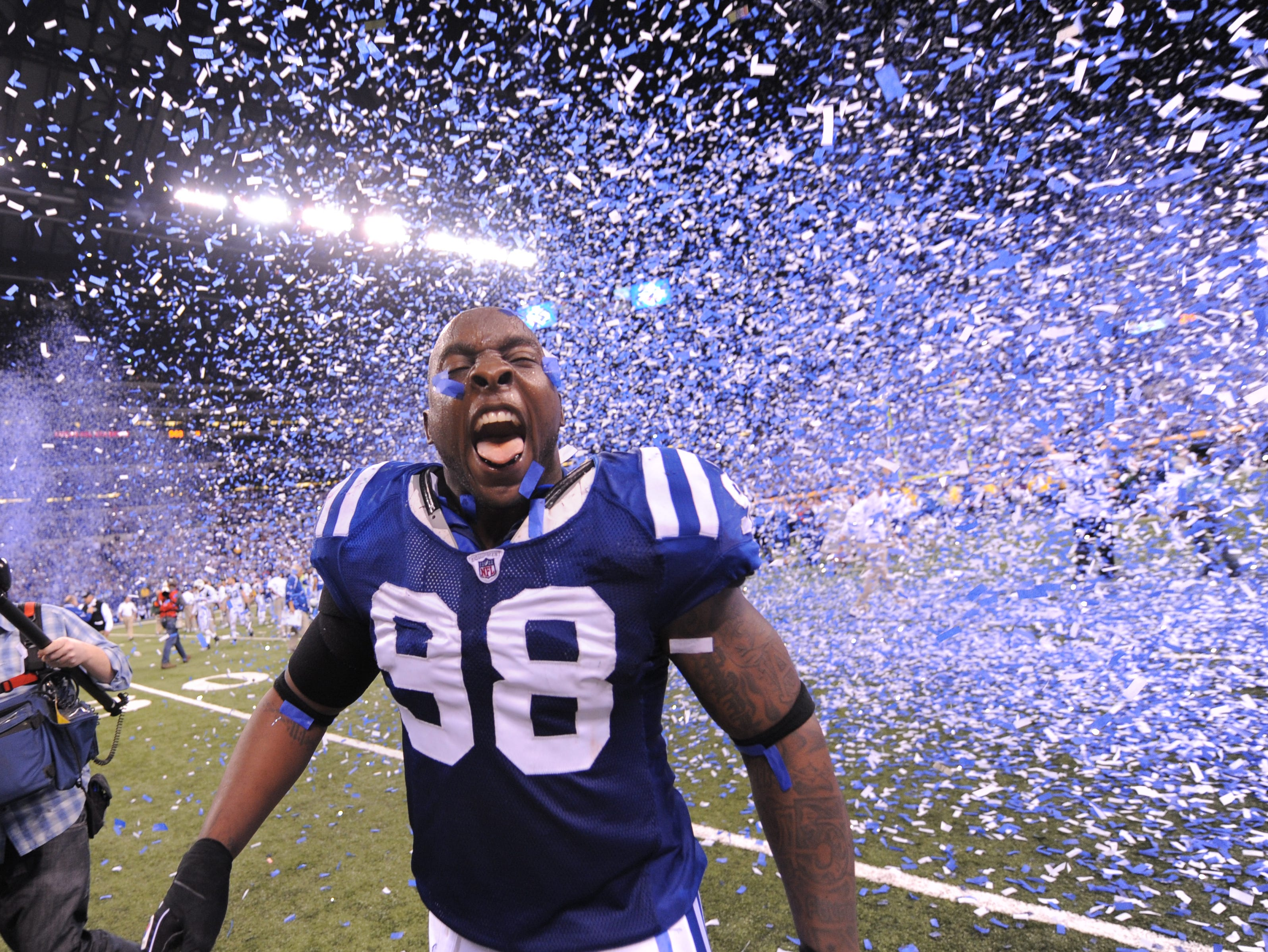 Indianapolis Colts Robert Mathis celebrates winning the AFC Championship game between the Colts and Jets at Lucas Oil Stadium on Sunday, January 24, 2010.