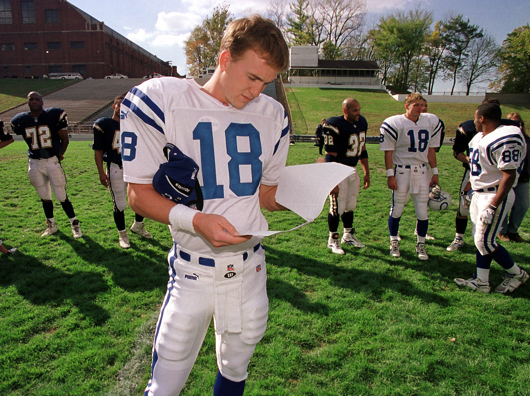 Indianapolis Colts quarterback Peyton Manning goes over his lines for a segment for a Disney television show for kids at the Butler Bowl on the campus of Butler University on Tuesday, Oct 19, 1999.