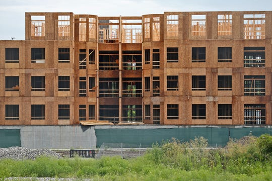 The JC Hart apartment complex and parking is seen under construction from the west, in Midtown Carmel, Tuesday, Aug. 7, 2018.