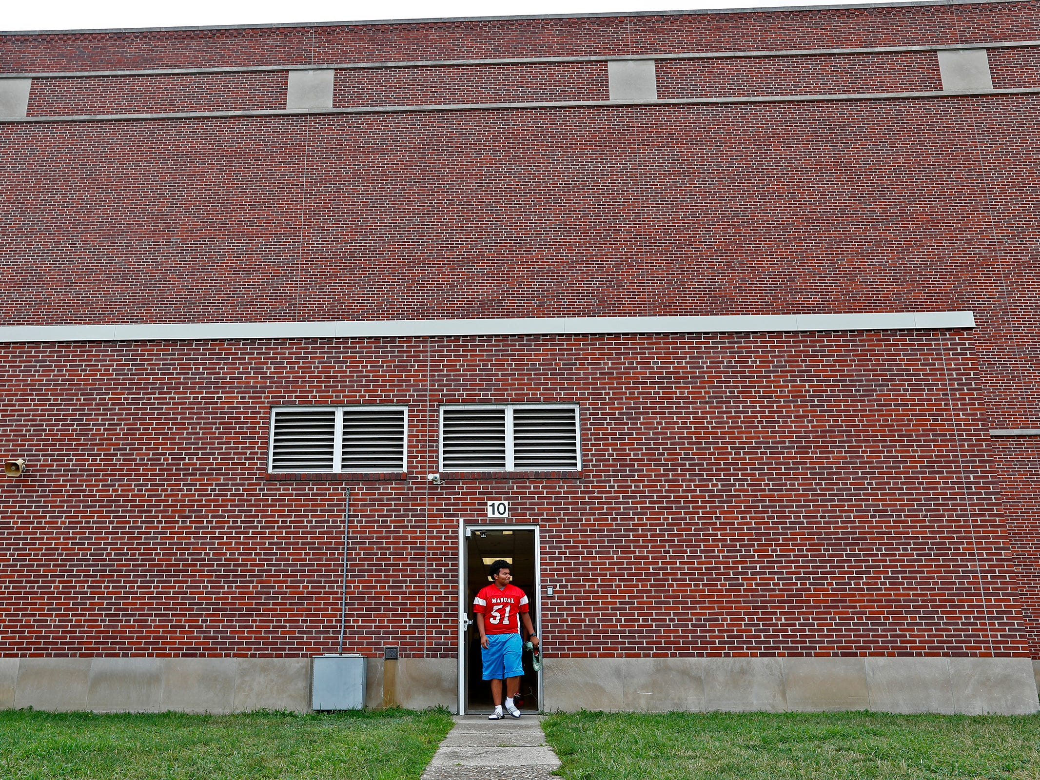 Lester heads out for football practice at Emmerich Manual High School, Monday, July 31, 2018.  He moved to Indianapolis when he was 15 years old and is set to graduate from Manual in 2019.  Lester, an undocumented immigrant from Honduras, dreams of going to college.  He hopes that football will help him pay for that dream.