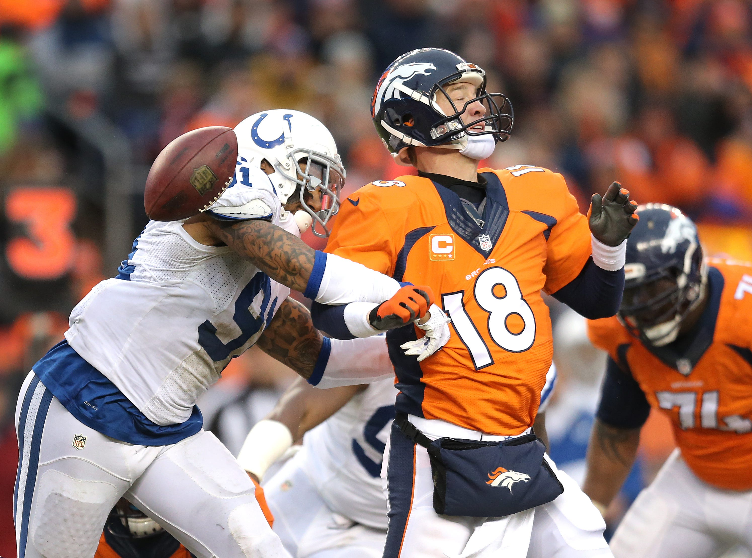 Indianapolis Colts linebacker Jonathan Newsome strips the ball from Denver Broncos quarterback Peyton Manning in the second quarter. Indianapolis faced Denver in their NFL playoff game Sunday, January 11, 2015.