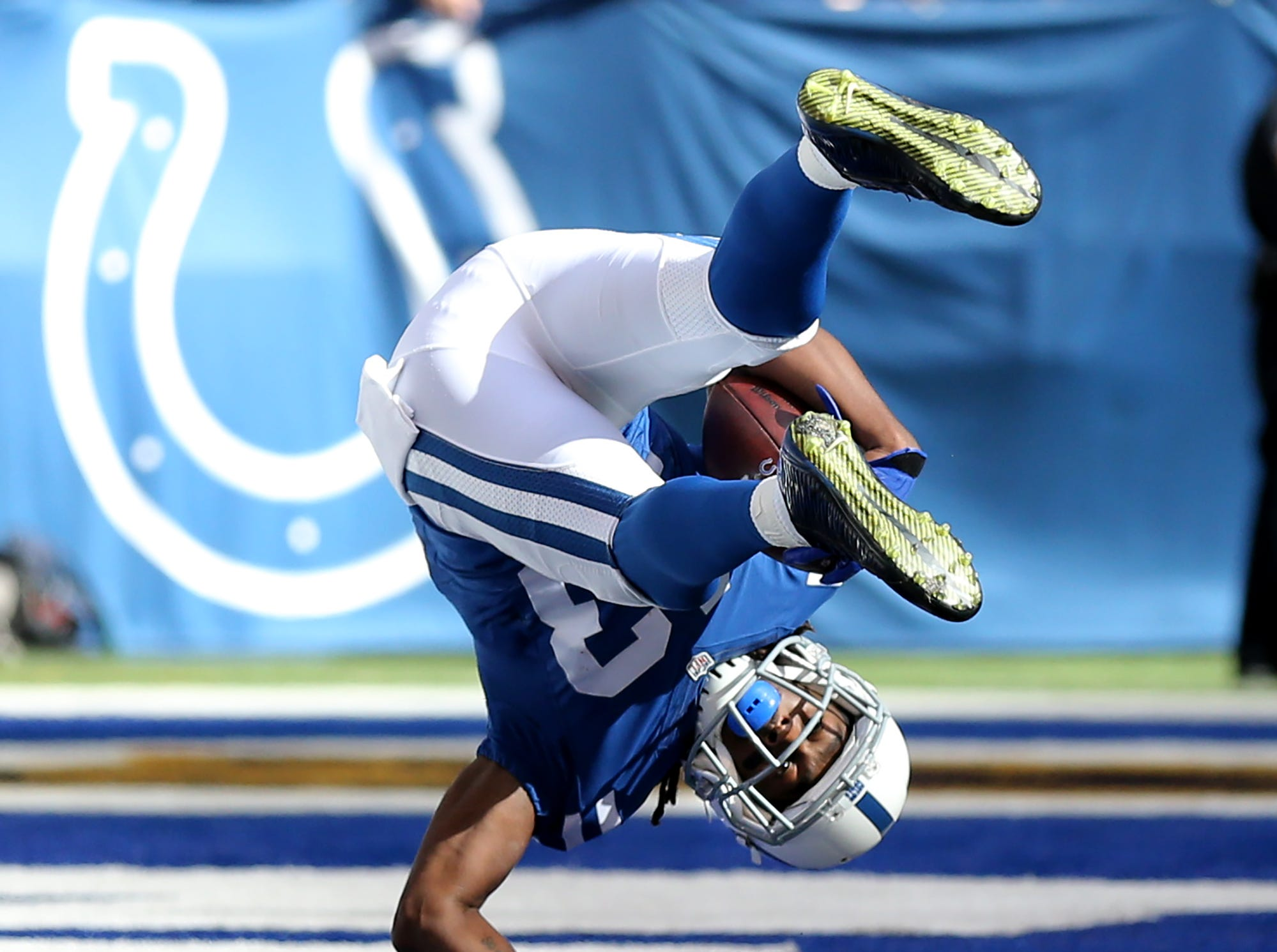 Indianapolis Colts wide receiver T.Y. Hilton (13) rolls into the end zone for show as he scores during the second half of an NFL football game Sunday, Oct. 25, 2015, at Lucas Oil Stadium.