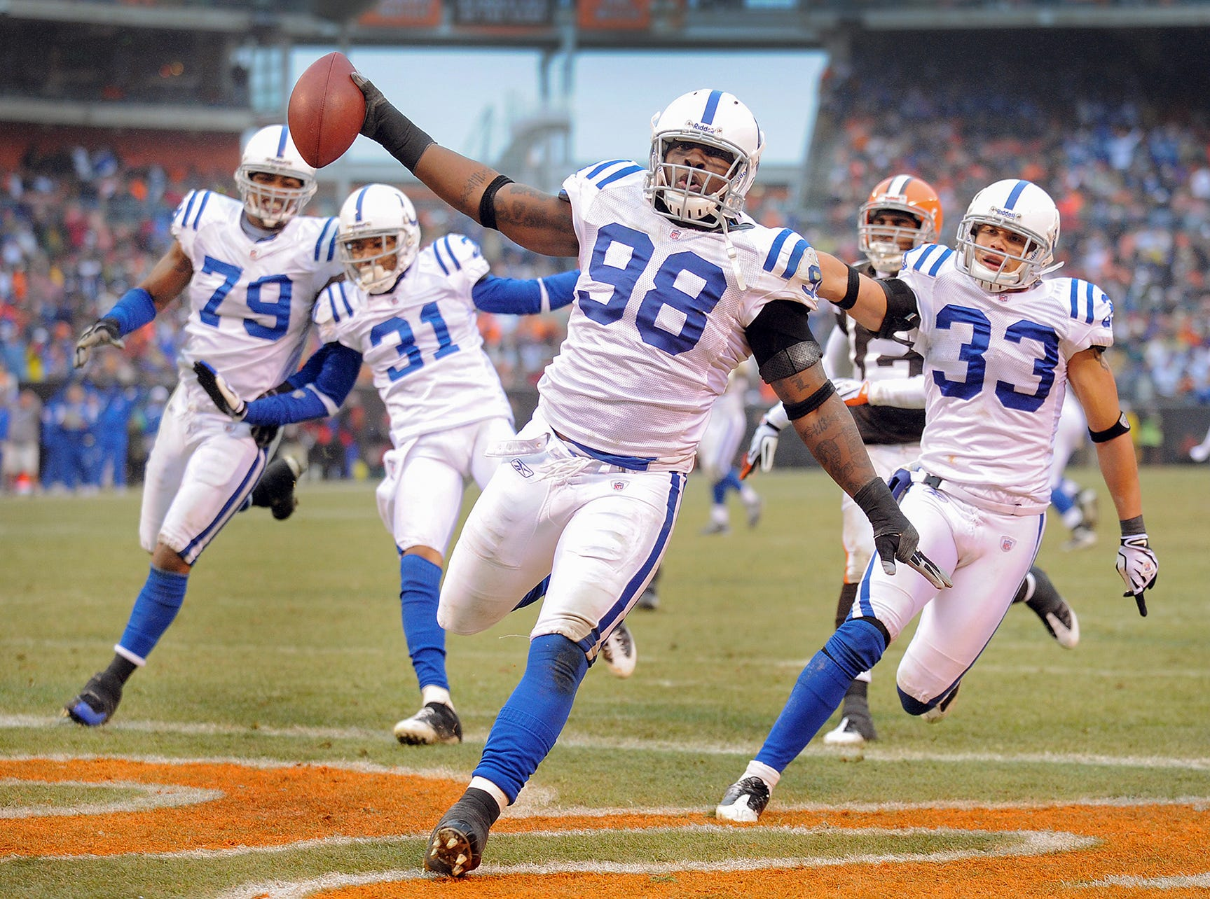 Indianapolis Colts Robert Mathis (#98) scores the game winning touchdown in the fourth of their game Sunday at Cleveland Browns Stadium in Cleveland OH. on November 30, 2008.
