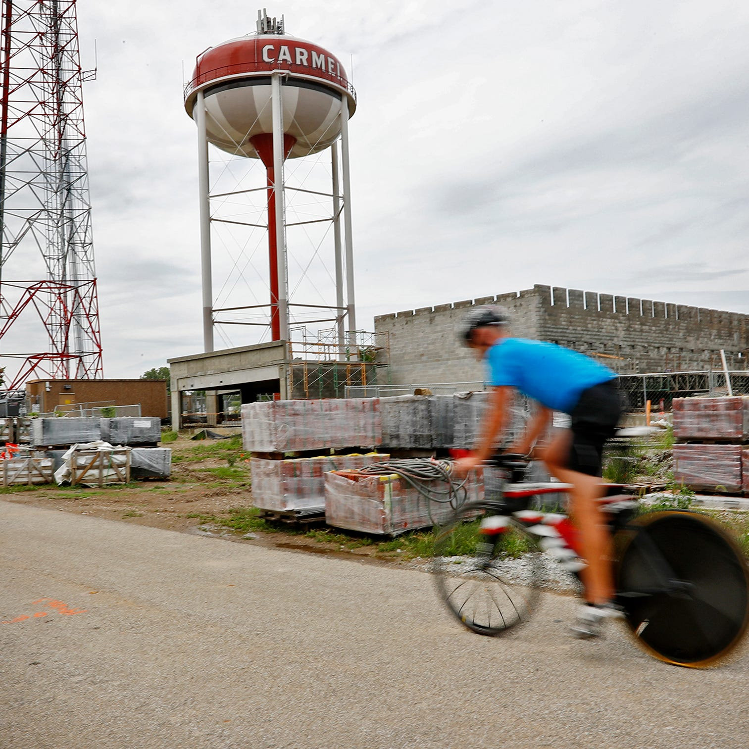A cyclist travels south on the Monon Trail,...