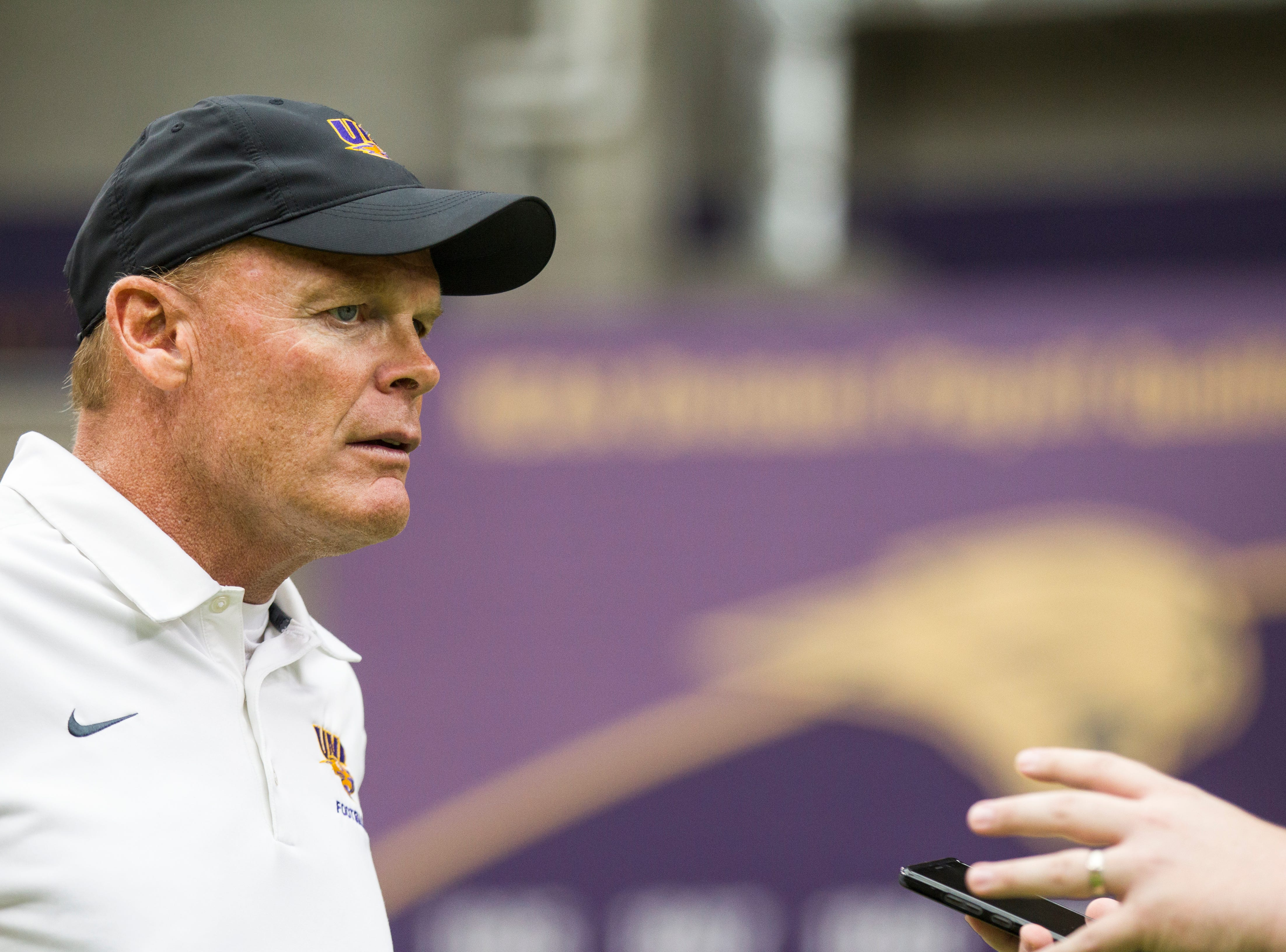 UNI head coach Mark Farley speaks with members of the media during media day on Wednesday, Aug. 8, 2018, at the UNI-Dome in Cedar Falls, Iowa.