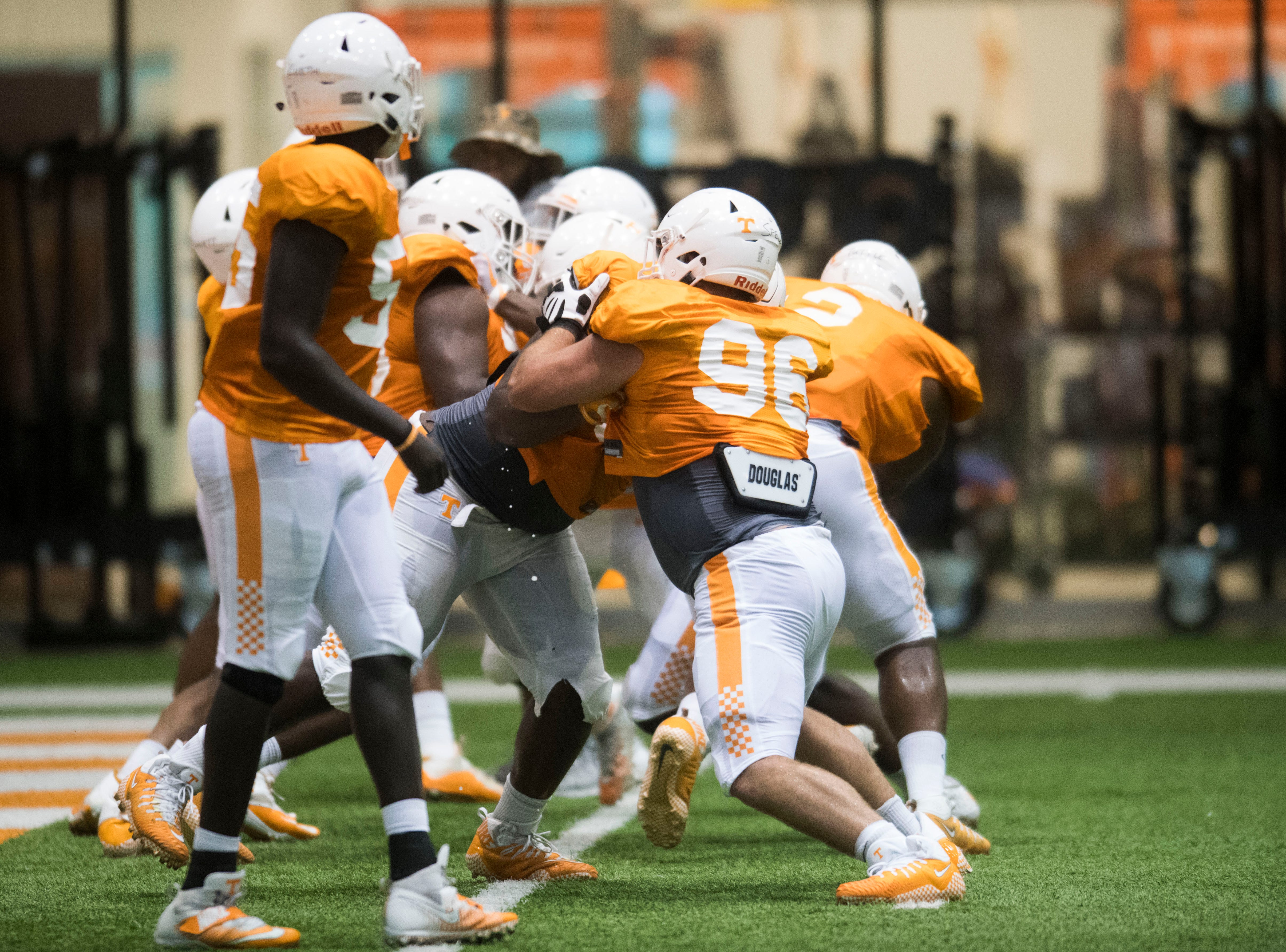Players participate in a drill during UT Vols preseason football practice Wednesday, Aug. 8, 2018.