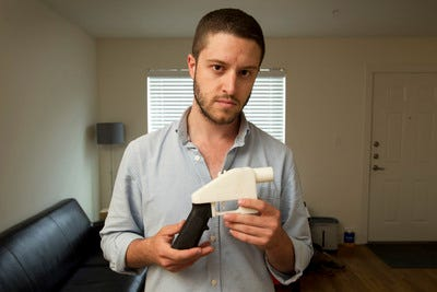 Cody Wilson shows the first completely 3D-printed handgun, the Liberator, at his home in Austin, Texas on Friday May 10, 2013.
