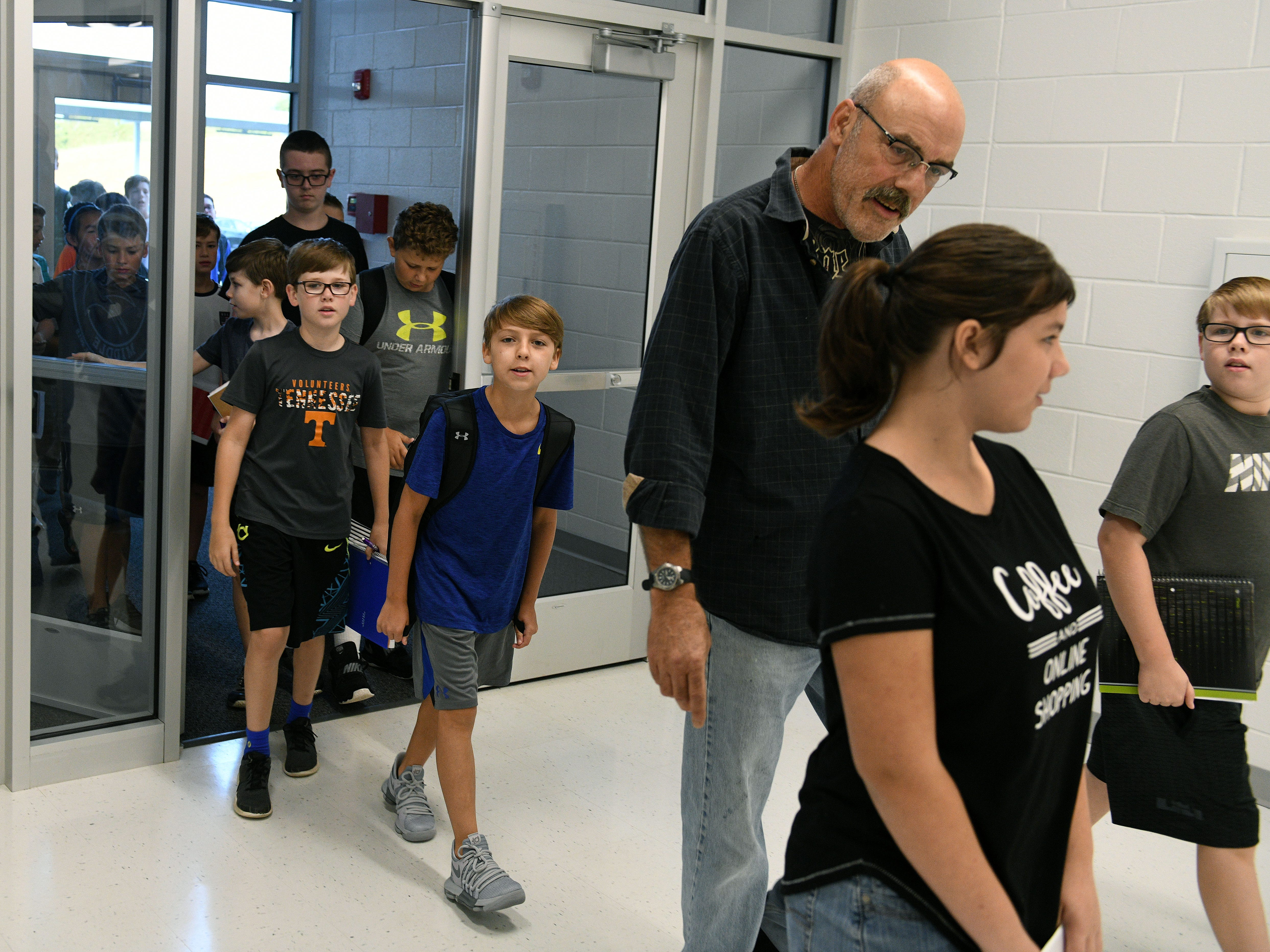 Parents and students pour in the doors at 7:30 a.m. for the first day at Hardin Valley Middle School Wednesday, August 8, 2018.